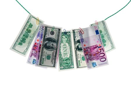underhand: Paper money on a clothesline isolated on white background. Money laundering.