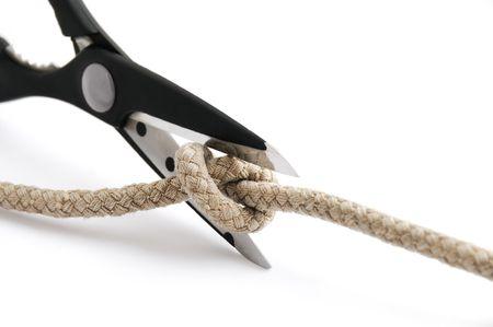 Schaar snijden een knoop � een probleemoplossend concept