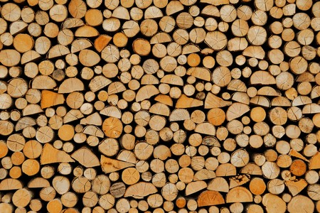 Wood stock background – stacked firewood pattern Stock Photo