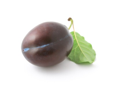 Single ripe plum with leaf isolated on white background Stock Photo - 7859304