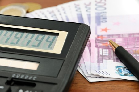 Paper money, coins, pen and calculator on the desk Stock Photo - 8120239