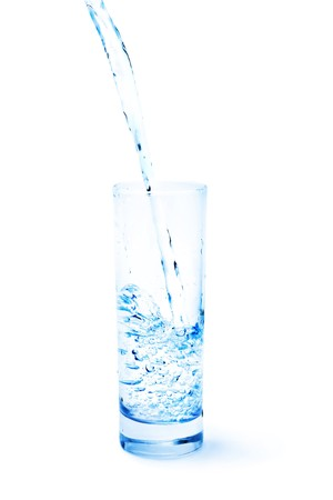 tonality: Clean water pouring into the glass isolated on white. Blue tonality. Stock Photo