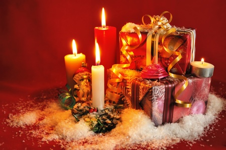 Christmas background with candles and beautiful gift boxes Stock Photo - 8277956