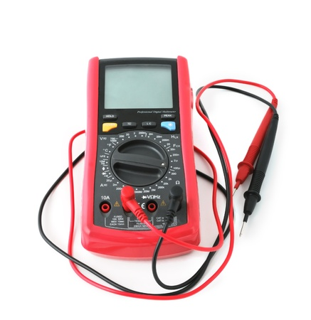 Professional digital multimeter isolated on white background photo