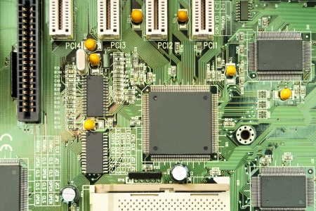 electrical parts: Technology background: a computer mother board with electrical paths and electronic components Stock Photo