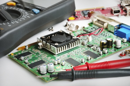 Circuit board and a multimeter in the lab