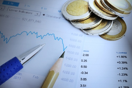 Financial chart and numbers, pen, pencil and money. Blue tonality. Stock Photo