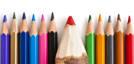 Colorful wooden pencils with, one of them is bigger then others.
