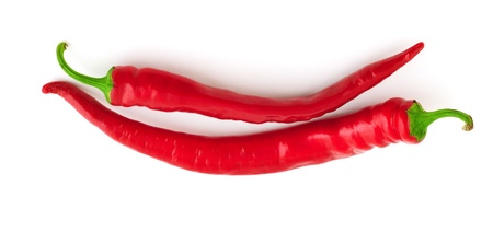 Fresh red hot chili peppers in the shape of smile isolated on white background Stock Photo - 10388279