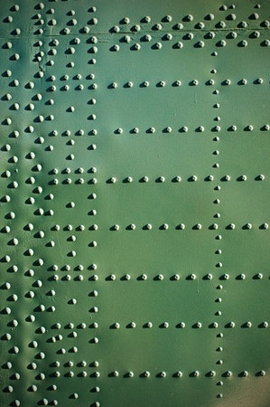 Old aircraft plating texture with rivets. Grunge wallpaper pattern. photo