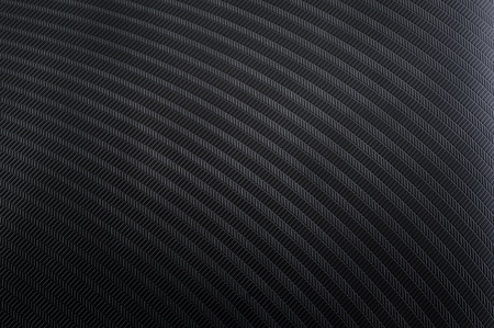 Black plastic textured surface with periodic rectangular patterns photo