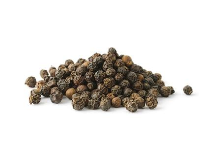 Pile of black whole pepper isolated on white background Standard-Bild