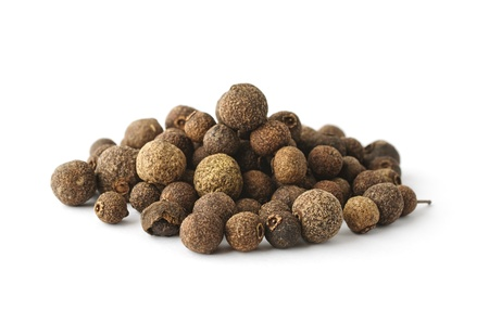 Pile of aromatic allspice isolated on white background