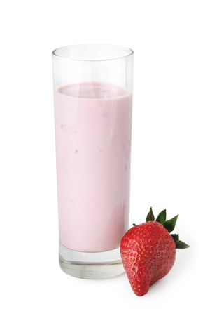 Glass with drinking yogurt and whole strawberry on white background