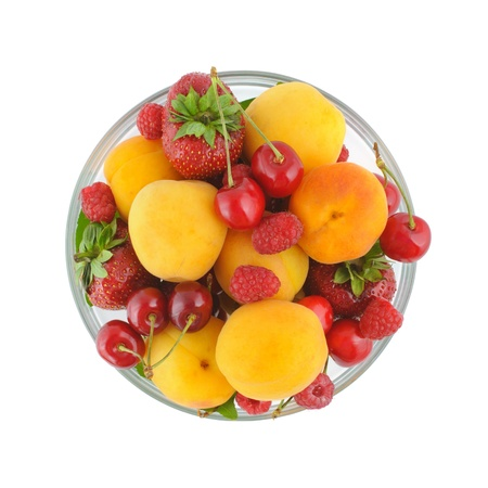 Glass bowl full of a variety of fresh berries  Top view, isolated on white with clipping path  Stok Fotoğraf