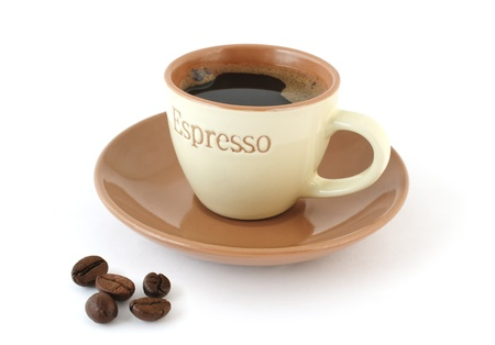 coffeebeans: Coffee in the cup with saucer and coffee-beans on white background