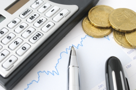 Finance background with coins, graph and calculator Stok Fotoğraf