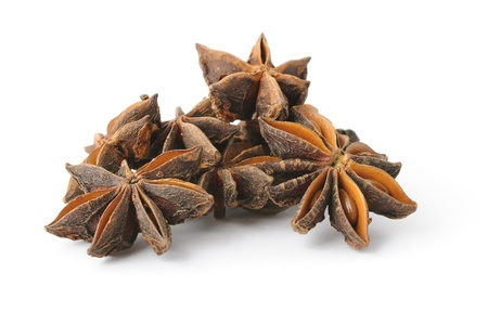 Heap of anise stars on white background with shadow Stock Photo - 14980065