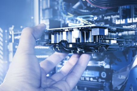 Computer engineer inserting a printed circuit board  Standard-Bild