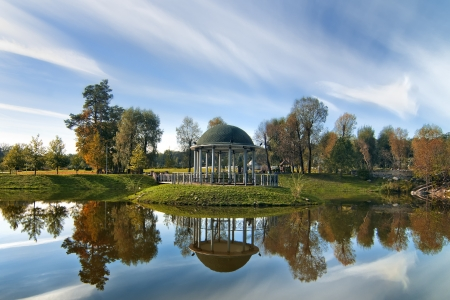 Idyllic autumn landscape  Lake with island and arbor with colorful trees and sky reflection  Stock Photo - 15856841