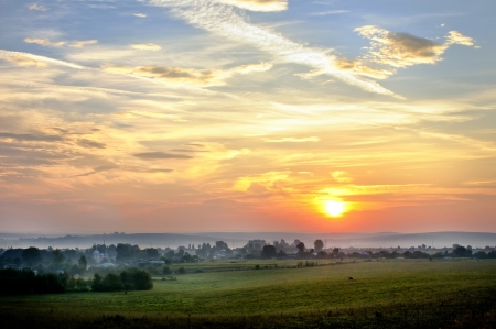 Beautiful landscape with sunrise in a countryside photo