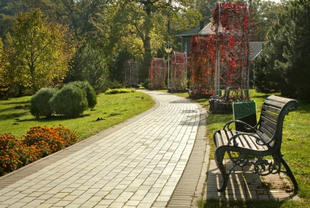 Beautiful park with pathway, arbors and benches  Stok Fotoğraf