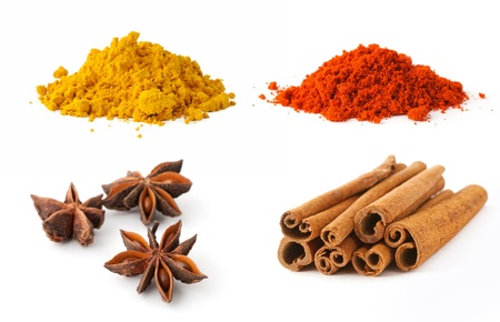 Curry, paprika, cinnamon and anise on white background Stock Photo - 17127777