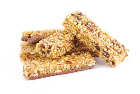 Heap of healthy cereal bars with fruits and nuts photo
