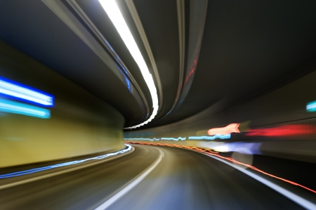 Abstract traffic motion lights in a tunnel photo