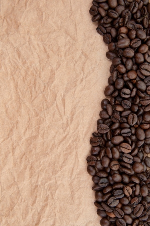 Background with coffee beans curve on a vintage parchment paper  photo