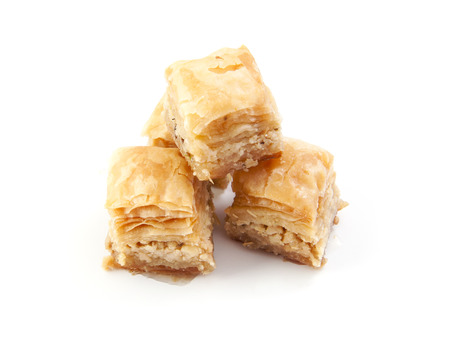 Heap of baklava sweets on white background