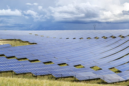 industry moody: Field of photovoltaic panels of a big solar energy power plant