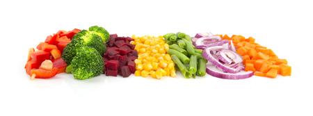 mixed vegetables: Colorful cut vegetables in a line with perspective isolated on white background