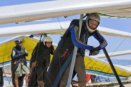 gliding: AGER, SPAIN � AUGUST 9, 2013: Ukrainian pilot Oleg Matvieiev waits on his turn to launch during  British Open hanggliding competitions.