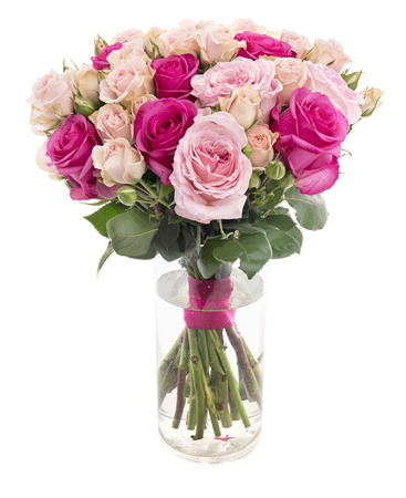 Beautiful roses bouquet in a glass vase isolated on white background
