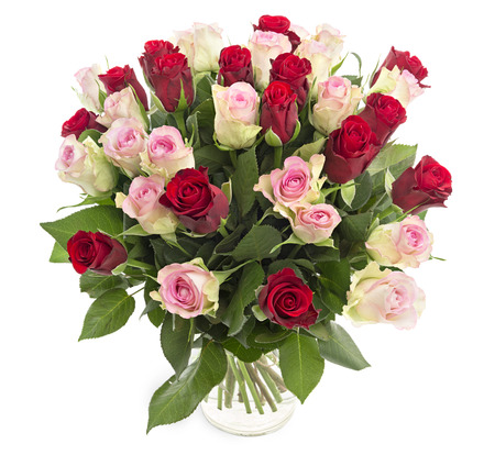 Beautiful fresh red and pink roses in a vase isolated on white background