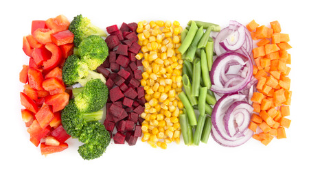 Cut vegetables ready for cooking isolated on white background