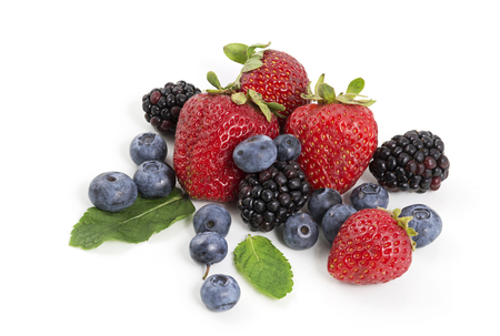 Heap of juicy berries isolated on white background