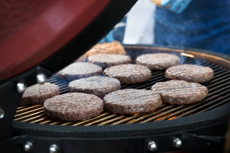 hamburger steak: Delicious beef burgers cooking on a barbecue Stock Photo