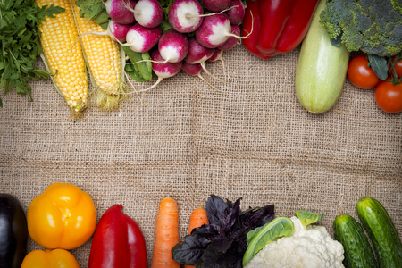 rukola: Vegetables frame on a sackcloth background with copy space for text Stock Photo