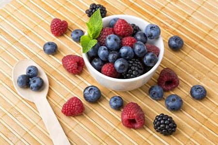 breakfast bowl: Fresh colorful berries in a bowl � healthy breakfast Stock Photo