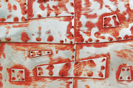 clinch: Metal background with scratches, red paint and rivets