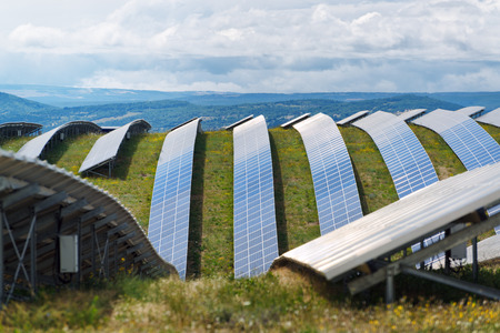 Rows of solar panels in the field on a plateau