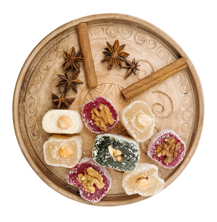 locum: Colorful oriental sweets with nuts, anise and cinnamon on an ornamental tray