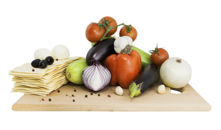 Vegetables and other ingredients for cooking lasagna.