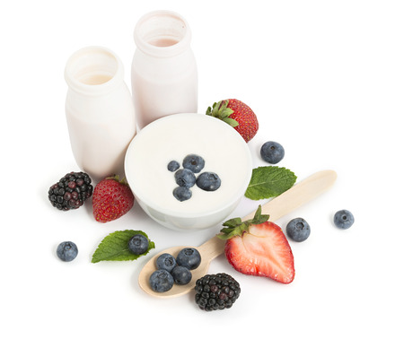 Drinking yogurts, berries and meant leaves on white background Stock Photo