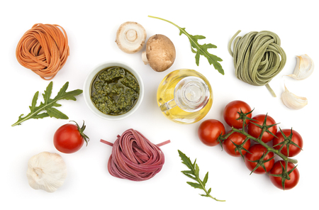 rukola: Colorful hand-made pasta and ingredients: vegetables and oil, top view. Italian healthy food cooking.