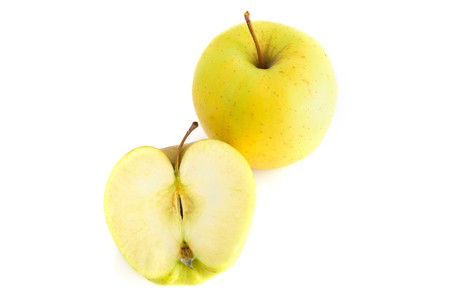 Top view of two fresh organic yellow apples isolated on white