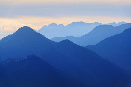 Beautiful calm evening mountains silhouettes in blue tonality