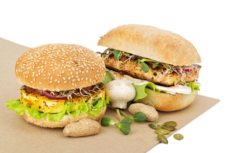 Healthy vegetarian burgers with tofu, vegetables and greens